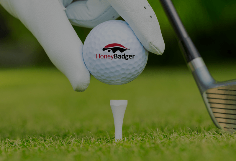 HoneyBadger golf ball logo